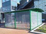 A bike parking cage installed by Western Australia's state government at all new rail stations. Is this what Adelaide's new enclosures will look like?