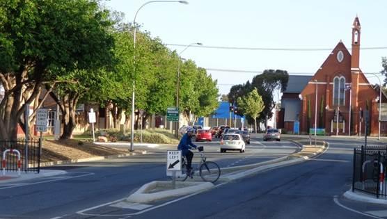 Negotiating Nelson Street's Improved Mid-Road Refuge.