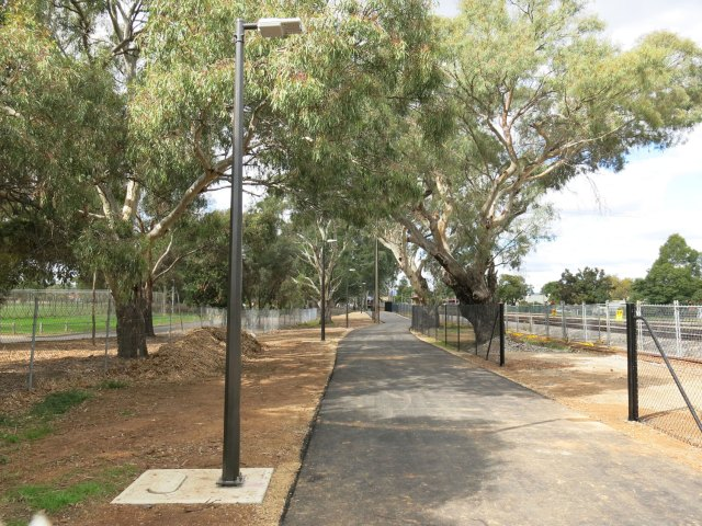 Outer Harbour Greenway: The new section of pathway looking towards Woodville Road. Dedicated lighting & rail reserve fence to the right. We expect the the old fence to the left to be removed.