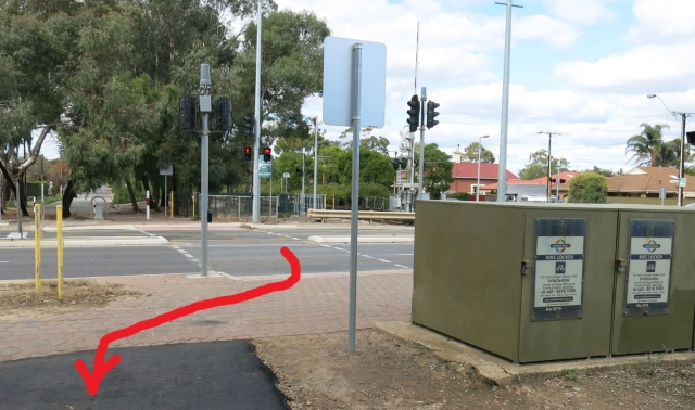 Outer Harbour Greenway: Unfortunately the transition from the bicycle & pedestrian crossing on Woodville Road to the new pathway is not as direct as it could be. The green boxes are bike lockers associated with the nearby rail station. They could perhaps have been moved...
